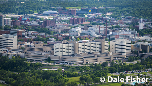 University Of Michigan Hospital with stadium in the summer
