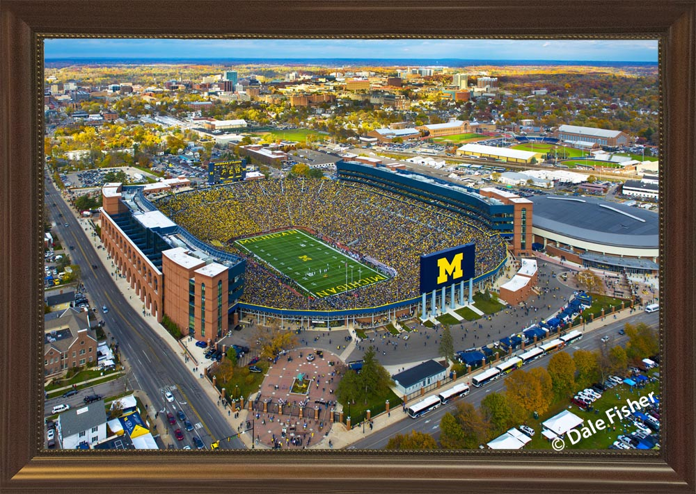 Photograph of the Framed Helicopter Aerial Photograph of Michigan Stadium taken 09-12-15 when the U-M Wolverines stomped the Oregon State Beavers 35 - 7. Coach Harbaugh celebrated his first win at the Big House witnessed by 109,651 Wolverine Fans.